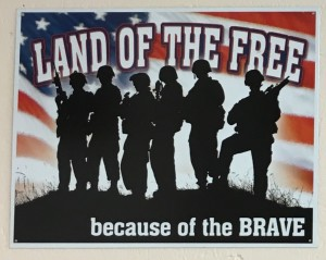 Land of the Free Because of the BRAVE (Sign)